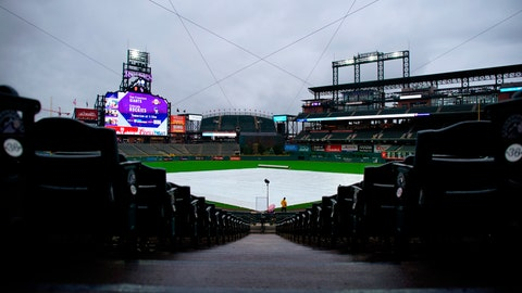 <p>               The tarp covers the field before a scheduled baseball game between the San Francisco Giants and the Colorado Rockies on Wednesday, May 8, 2019, in Denver. (AP Photo/Jack Dempsey)             </p>