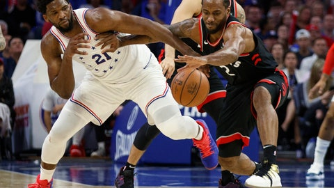 <p>               Toronto Raptors' Kawhi Leonard, right, reaches for the ball as he holds off Philadelphia 76ers' Joel Embiid, left, during the second half of Game 3 of a second-round NBA basketball playoff series Thursday, May 2, 2019, in Philadelphia. The 76ers won 116-95. (AP Photo/Chris Szagola)             </p>