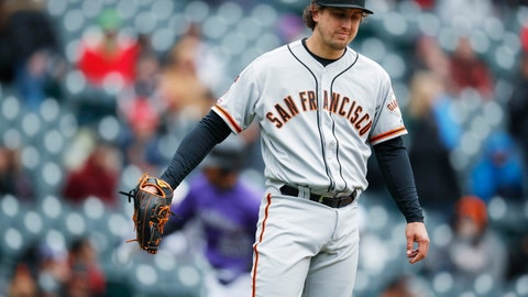 <p>               San Francisco Giants starting pitcher Derek Holland calls for a new ball after giving up a two-run home run to Colorado Rockies' Ian Desmond in the second inning of a baseball game Thursday, May 9, 2019, in Denver. (AP Photo/David Zalubowski)             </p>