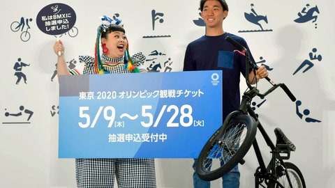 """<p>               Japanese comedian Naomi Watanabe, left, and BMX rider Rimu Nakamura attend an event to mark the start of application to buy tickets for the 2020 Tokyo Olympic Games, in Tokyo Thursday, May 8, 2019. Japan residents began Thursday entering a lottery system, hoping to land tickets for next year's Tokyo Olympics. The sign reads """" Tickets for the 2020 Tokyo Olympic Games. Open for entering a lottery system."""" (Yu Nakajima/Kyodo News via AP)             </p>"""
