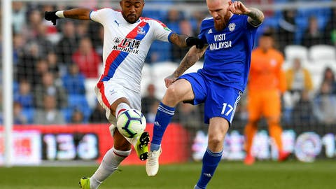 <p>               Crystal Palace's Jordan Ayew, left, and Cardiff City's Aron Gunnarsson battle for the ball during their English Premier League soccer match at Cardiff City Stadium, Cardiff, Wales, Saturday May 4, 2019. (Simon Galloway/PA via AP)             </p>