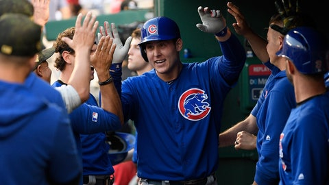 <p>               Chicago Cubs' Anthony Rizzo celebrates his home run in the dugout during the third inning of a baseball game against the Washington Nationals, Sunday, May 19, 2019, in Washington. (AP Photo/Nick Wass)             </p>