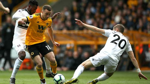 <p>               Fulham's Ryan Sessegnon, left, and Wolverhampton Wanderers' Diogo Jota battle for the ball during the English Premier League soccer match at Molineux, Wolverhampton, England, Saturday May 4, 2019. (Nick Potts/PA via AP)             </p>