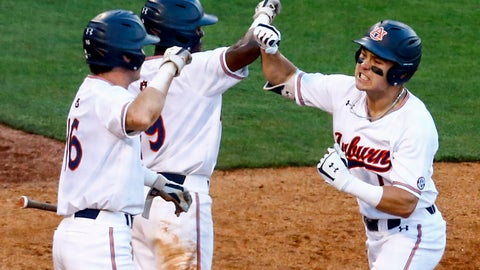 <p>               Auburn's Judd Ward (1) celebrates with teammates Ryan Bliss (9) and Kason Howell (16) after hitting a two run homer during the seventh inning of the Southeastern Conference tournament NCAA college baseball game against Tennessee, Tuesday, May 21, 2019, in Birmingham, Ala. (AP Photo/Butch Dill)             </p>