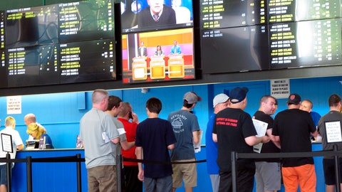 <p>               FILE - In this June 19, 2018, file photo, sports bettors line up at windows at Monmouth Park racetrack in Oceanport, N.J. With the legalization of sports gambling in the United States and its gradually expanding implantation, some in the industry are suggesting horse racing add fixed-odds wagering as a way to respond to the changing landscape, evolve and compete with the other options now available. (AP Photo/Wayne Parry, File)             </p>