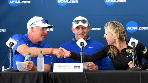 <p>               Ryan Colton, NCAA Division I Women's Golf Committee chair, center, watches as Duke women's golf coach Dan Brooks, left, shakes hands with Wake Forest women's golf coach Kim Lewellen after completing the parings for the final round of an NCAA college golf tournament, Wednesday, May 23, 2019, in Fayetteville, Ark. (AP Photo/Michael Woods)             </p>