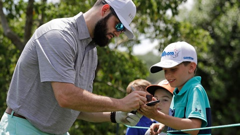 <p>               Carolina Panthers draft pick Will Grier wtakes signs an autograph for a fan on the second hole during the pro-am of the Wells Fargo Championship golf tournament at Quail Hollow Club in Charlotte, N.C., Wednesday, May 1, 2019. Grier is kicking off his NFL career with the swagger of a starting NFL quarterback. The adulation surrounding the third-pick pick has created a buzz about the Panthers' QB situation with Cam Newton coming off shoulder surgery. (AP Photo/Chuck Burton)             </p>