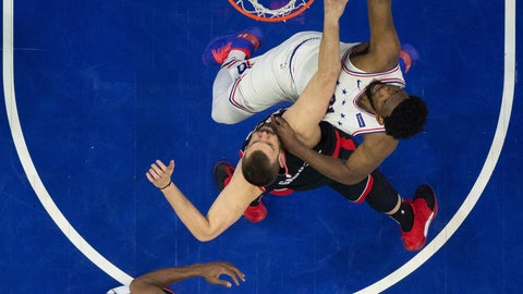 <p>               Philadelphia 76ers' Joel Embiid, right, shoots against Toronto Raptors' Marc Gasol, center, with Kawhi Leonard, left, watching during the first half of Game 3 of a second-round NBA basketball playoff series, Thursday, May 2, 2019, in Philadelphia. (AP Photo/Chris Szagola)             </p>
