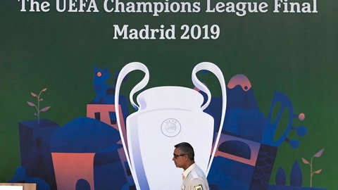 <p>               An employee from a security firm walks past a Champions League banner in downtown Madrid, Spain, Wednesday, May 29, 2019. Madrid will be hosting the final again after nearly a decade, but the country's streak of having at least one team playing for the European title ended this year after five straight seasons, giving home fans little to cheer for when Tottenham faces Liverpool at the Wanda Metropolitano Stadium on Saturday. (AP Photo/Tales Azzoni)             </p>