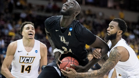 <p>               FILE- In this March 22, 2019 file photo, Central Florida center Tacko Fall (24) is fouled by VCU guard Mike'L Simms, right, during the second half of a first-round game in the NCAA men's college basketball tournament in Columbia, S.C. The NBA has picked 11 players from the G League Elite Camp to stay for the NBA draft combine that starts Thursday, May 16. Fall, Florida State's Terance Mann, Miami's Dewan Hernandez, Syracuse's Oshae Brissett, Nevada's Cody Martin, Tulsa's DaQuan Jeffries, Auburn's Jared Harper, Iowa's Tyler Cook, Iowa State's Marial Shayok, Mississippi State's Reggie Perry and Ole Miss' Terence Davis were invited Wednesday, May 15 to stay. (AP Photo/Sean Rayford, File)             </p>
