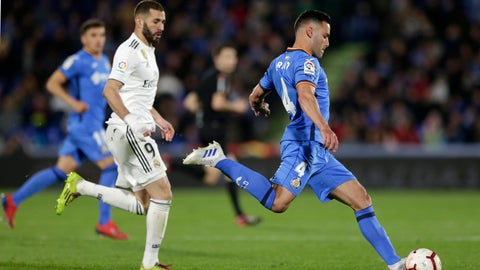 <p>               Getafe's Bruno Gonzalez, right, attempts a shot during a Spanish La Liga soccer match between Getafe and Real Madrid at the Alfonso Perez stadium in Getafe, Spain, Thursday, April 25, 2019. (AP Photo/Bernat Armangue)             </p>