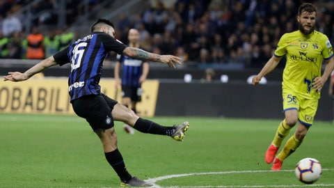 <p>               Inter Milan's Matteo Politano scores his side's opening goalduring a Serie A soccer match between Inter Milan and Chievo, at the San Siro stadium in Milan, Italy, Monday, May 13, 2019. (AP Photo/Luca Bruno)             </p>