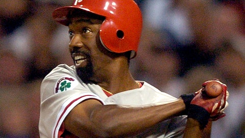 <p>               FILE - In this Aug. 4, 2004, file photo, Philadelphia Phillies' Doug Glanville follows through on an RBI triple hit off San Diego Padres pitcher Adam Eaton during the third inning in San Diego. The Chicago Cubs say they're investigating a fan using what appeared to be an offensive hand gesture associated with racism behind Glanville, now a television reporter, who was on the air for NBC Sports Chicago. (AP Photo/Denis Poroy, File)             </p>