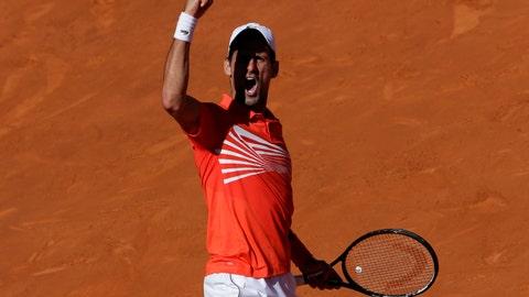 <p>               Nova Djokovic of Serbia celebrates a point during the Madrid Open tennis match against Dominic Thiem of Austria in Madrid, Spain, Saturday, May 11, 2019. (AP Photo/Bernat Armangue)             </p>