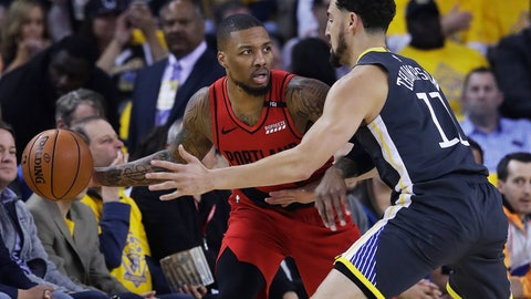 <p>               Portland Trail Blazers guard Damian Lillard, left, is defended by Golden State Warriors guard Klay Thompson during the first half of Game 2 of the NBA basketball playoffs Western Conference finals in Oakland, Calif., Thursday, May 16, 2019. (AP Photo/Jeff Chiu)             </p>