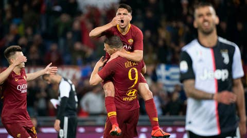 <p>               Romas Edin Dzeko, center, jubilates with his teammates Romas Cengiz Under, right, and Romas Stephan El Shaarawy after scoring the 2-0 goal during Serie A soccer match as Roma - FC Juventus at Olimpico Stadium in Rome, Sunday, May 12, 2019. (Claudio Peri/ANSA via AP)             </p>