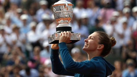 <p>               FILE - In this June 9, 2018, file photo, Romania's Simona Halep holds the trophy as she celebrates after defeating against Sloane Stephens, of the United States, 3-6, 6-4, 6-1, in the finals of the French Open tennis tournament at the Roland Garros stadium in Paris, France. (AP Photo/Alessandra Tarantino, File)             </p>