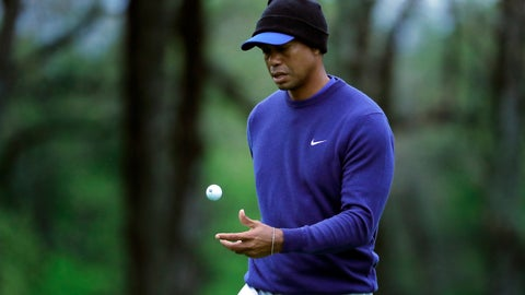 <p>               Tiger Woods flips his ball as he walks along the ninth green during a practice round for the PGA Championship golf tournament, Monday, May 13, 2019, in Farmingdale, N.Y. (AP Photo/Julie Jacobson)             </p>