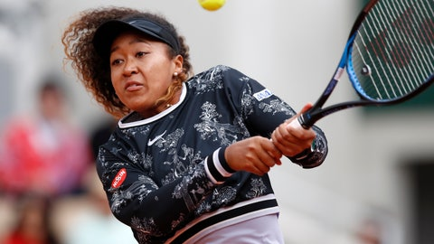 <p>               Japan's Naomi Osaka plays a shot against Slovakia's Anna Karolina Schmiedlova during their first round match of the French Open tennis tournament at the Roland Garros stadium in Paris, Tuesday, May 28, 2019. (AP Photo/Christophe Ena )             </p>