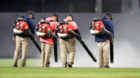 <p>               Groundskeeper use leaf blowers to remove water from the field at Yankee Stadium before a baseball game between the New York Yankees and the Baltimore Orioles, Monday, May 13, 2019, in New York. The game was postponed until Wednesday afternoon due to unplayable field conditions. (AP Photo/Kathy Willens)             </p>