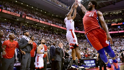 <p>               Philadelphia 76ers center Joel Embiid (21) fails to stop Toronto Raptors forward Kawhi Leonard's (2) last-second basket during the second half of an NBA Eastern Conference semifinal basketball game in Toronto on Sunday, May 12, 2019. (Frank Gunn/The Canadian Press via AP)             </p>
