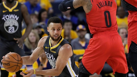 <p>               Golden State Warriors guard Stephen Curry, bottom, passes the ball as Portland Trail Blazers guard Damian Lillard (0) and center Enes Kanter defend during the second half of Game 2 of the NBA basketball playoffs Western Conference finals in Oakland, Calif., Thursday, May 16, 2019. (AP Photo/Jeff Chiu)             </p>