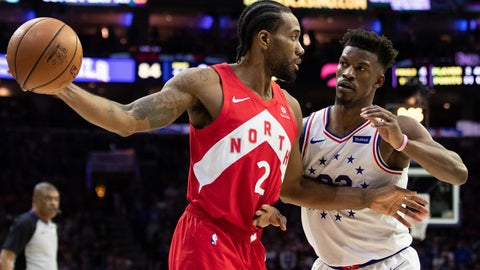 <p>               Toronto Raptors' Kawhi Leonard, left, holds the ball away from Philadelphia 76ers' Jimmy Butler, right, during the second half of Game 4 of a second-round NBA basketball playoff series, Sunday, May 5, 2019, in Philadelphia. The Raptors won 101-96. (AP Photo/Chris Szagola)             </p>