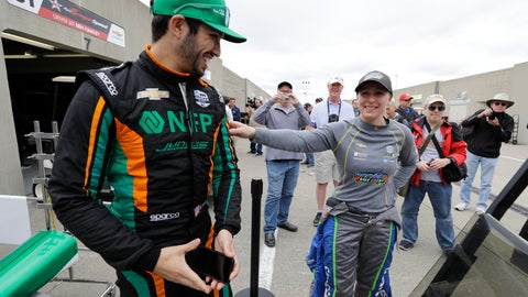 <p>               Kyle Kaiser, left, and Pippa Mann, of England, talk in the garage area before the start of practice for the Indianapolis 500 IndyCar auto race at Indianapolis Motor Speedway, Monday, May 20, 2019, in Indianapolis. (AP Photo/Darron Cummings)             </p>