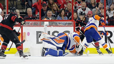 <p>               Carolina Hurricanes' Teuvo Teravainen, right, of Finland, scores against New York Islanders goalie Robin Lehner (40), of Sweden, while Islanders Anders Lee defends at right during the first period of Game 3 of an NHL hockey second-round playoff series in Raleigh, N.C., Wednesday, May 1, 2019. (AP Photo/Gerry Broome)             </p>