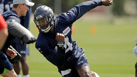 """<p>               In this Friday, May 3, 2019 photo, Seattle Seahawks rookie wide receiver DK Metcalf runs a drill during NFL football rookie mini camp in Renton, Wash. It took one rookie minicamp practice for Metcalf to catch the attention of Seahawks coach Pete Carroll. """"Maybe he's even more unique than we thought coming in,"""" Carroll says. (AP Photo/Ted S. Warren)             </p>"""