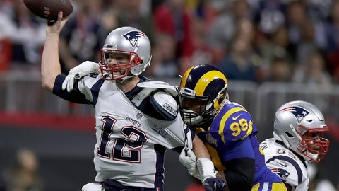 """<p>               File-This Feb. 3, 2019 file photo shows New England Patriots' Tom Brady (12) passing under pressure form Los Angeles Rams' Aaron Donald (99) during the first half of the NFL Super Bowl 53 football game in Atlanta. Brady will soon slip on his sixth Super Bowl ring, and Herb Adderley is the only other man on the planet who can relate to that level of success as the National Football League celebrates its 100th season. """"It's going to be a long time, another 100 years, before somebody wins himself six titles,"""" said Adderley, the Hall of Fame cornerback for Vince Lombardi's great Green Bay Packers teams of the 1960s. (AP Photo/Carolyn Kaster, File)             </p>"""