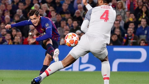 <p>               Barcelona's Philippe Coutinho, left, shoots on goal as Liverpool's Virgil Van Dijk tries to block the shot during the Champions League semifinal first leg soccer match between FC Barcelona and Liverpool at the Camp Nou stadium in Barcelona, Spain, Wednesday, May 1, 2019. (AP Photo/Manu Fernandez)             </p>