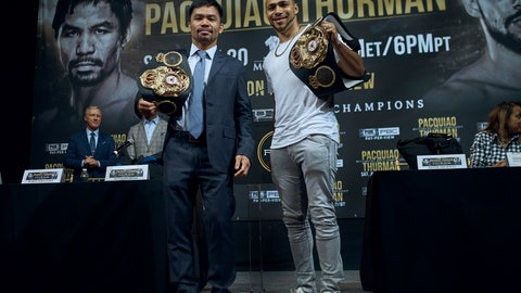 <p>               Manny Pacquiao, left, and Keith Thurman  pose for a picture during a news conference on Tuesday, May 21, 2019, in New York. The two are scheduled to fight in a welterweight world championship boxing bout on Saturday, July 20, in Las Vegas. (AP Photo/Andres Kudacki)             </p>