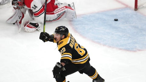 <p>               Boston Bruins' Brad Marchand (63) raises his stick as Carolina Hurricanes goaltender Petr Mrazek (34), of the Czech Republic, drops to the ice after a goal by Patrice Bergeron during the third period in Game 1 of the NHL hockey Stanley Cup Eastern Conference finals Thursday, May 9, 2019, in Boston. (AP Photo/Charles Krupa)             </p>