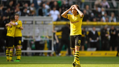 <p>               Dortmund's Axel Witsel reacts after the German Bundesliga soccer match between Borussia Moenchengladbach and Borussia Dortmund in Moenchengladbach, Germany, Saturday, May 18, 2019. Dortmund finished the season on the second place behind Bayern Munich. (AP Photo/Martin Meissner)             </p>