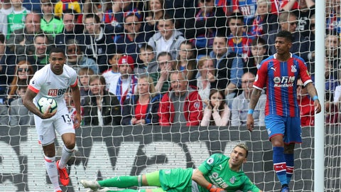 <p>               Bournemouth's Callum Wilson collects the ball from the back of the net after team mate Jordon Ibe scores to make it 3-2 during the English Premier League soccer match between Crystal Palace and Bournemouth at Selhurst Park stadium, London, England. Sunday, May 12, 2019. (Bradley Collyer/PA via AP)             </p>