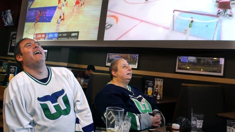 <p>               Hartford Whaler Booster club members Matthew Greene, left, and Joanne Coressa watch Game 1 of the NHL Eastern Conference playoff series on Thursday, May 9, 2019, at a restaurant in Manchester, Conn., between the Carolina Hurricanes, the franchise that moved from Hartford 22 years ago, and the Boston Bruins. (AP Photo/Pat Eaton-Robb)             </p>