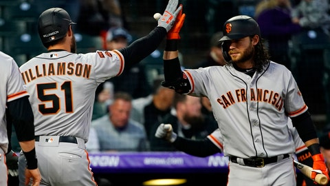 <p>               San Francisco Giants' Mac Williamson high-fives Brandon Crawford (35) after hitting a three-run home run against the Colorado Rockies during the fourth inning of a baseball game, Tuesday, May 7, 2019, in Denver. (AP Photo/Jack Dempsey)             </p>