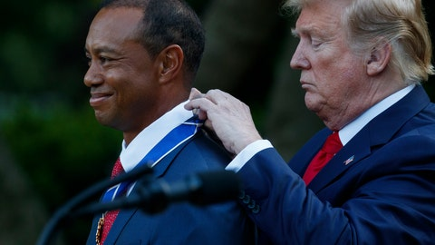 <p>               President Donald Trump presents golfer Tiger Woods with the Presidential Medal of Freedom, in the Rose Garden of the White House, Monday, May 6, 2019, in Washington. (AP Photo/Evan Vucci)             </p>