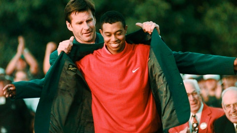 <p>               FILE - In this April 13, 1997, file photo, Masters champion Tiger Woods receives his Green Jacket from last year's winner Nick Faldo, rear, at the Augusta National Golf Club in Augusta, Ga. Woods completes an amazing journey by winning the 2019 Masters, overcoming 11 years of personal foibles and professional pain that seemed likely to be his lasting legacy. (AP Photo/Dave Martin, File)             </p>
