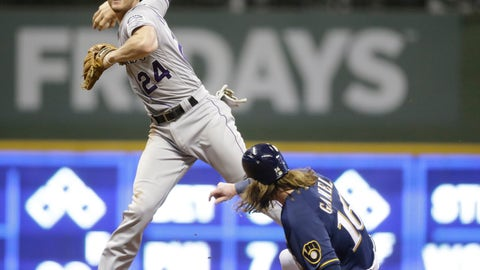 <p>               Colorado Rockies' Ryan McMahon forces out Milwaukee Brewers' Ben Gamel at second base and throws on to first for a double play on Orlando Arcia during the eighth inning of a baseball game Wednesday, May 1, 2019, in Milwaukee. (AP Photo/Jeffrey Phelps)             </p>