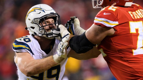 <p>               FILE - In this Dec. 13, 2018, file photo, Los Angeles Chargers defensive end Joey Bosa (99) tries to get past Kansas City Chiefs offensive tackle Eric Fisher (72) during an NFL football game in Kansas City, Mo. Bosa is hoping to return to form with the Chargers wearing a new yet familiar number. The defensive end has switched from No. 99 to 97. Bosa wore that number at St. Thomas Aquinas High School in Fort Lauderdale, Florida, and at Ohio State. It is also a significant number for the Bosa family. John Bosa wore No. 97 for three seasons in the NFL and Nick Bosa, Joey's younger brother, will wear it for San Francisco after being the second overall pick in the April draft. (AP Photo/Reed Hoffmann, File)             </p>