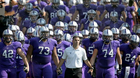"""<p>               FILE - In this Sept. 27, 2014, file photo, St. Thomas coach Glen Caruso leads his team onto the field for a college football game against St. John's, in St. Paul, Minn. The Minnesota Intercollegiate Athletic Conference has decided to oust the NCAA Division III league's largest school, St. Thomas, for competitive purposes. The MIAC announced Wednesday, May 22, 2019, the Tommies will be """"involuntarily removed"""" in two years by the conference they helped found in 1920. (Jim Gehrz/Star Tribune via AP)             </p>"""