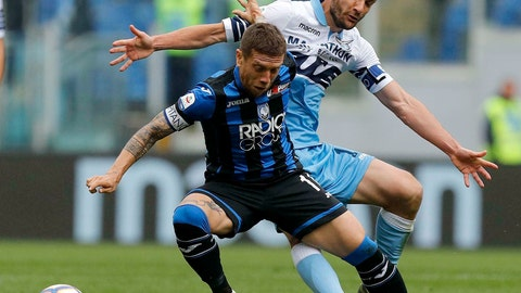 <p>               Atalanta's Papu Gomez and Lazio's Marco Parolo, right, vie for the ball during the Serie A soccer match between Lazio and Atalanta at the Olympic stadium in Rome, Sunday, May 5, 2019. (Giuseppe Lami/ANSA via AP)             </p>