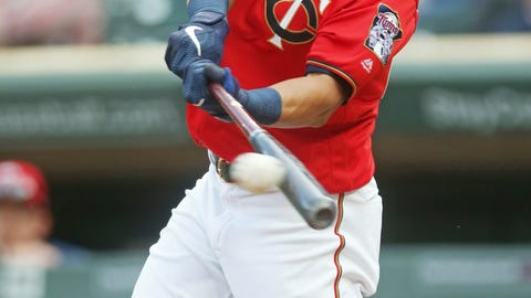 <p>               Minnesota Twins' Eddie Rosario hits an RBI single off Los Angeles Angels pitcher Cam Bedrosian in the first inning of a baseball game Tuesday, May 14, 2019, in Minneapolis. (AP Photo/Jim Mone)             </p>