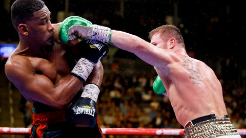 <p>               Canelo Alvarez, right, of Mexico, tries to hit Daniel Jacobs with a left during a middleweight title boxing match Saturday, May 4, 2019, in Las Vegas. (AP Photo/John Locher)             </p>
