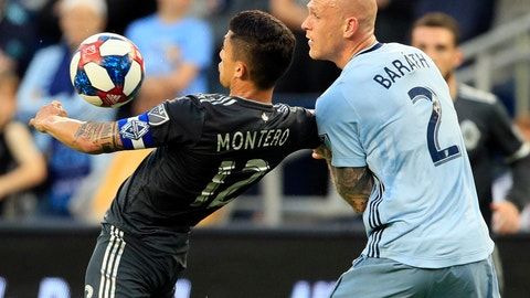 <p>               Vancouver Whitecaps forward Fredy Montero, left, controls the ball around Sporting Kansas City defender Botond Barath (2) during the first half of an MLS soccer match in Kansas City, Kan., Saturday, May 18, 2019. (AP Photo/Orlin Wagner)             </p>