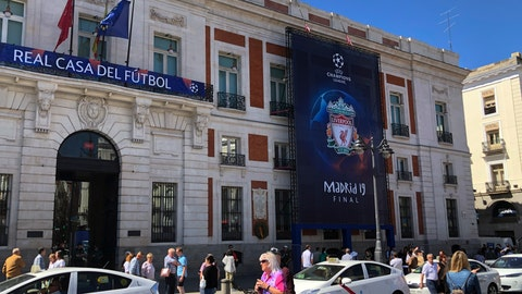 <p>               Pedestrians walk past Champions League banner in downtown Madrid, Spain, Wednesday, May 29, 2019. Madrid will be hosting the final again after nearly a decade, but the country's streak of having at least one team playing for the European title ended this year after five straight seasons, giving home fans little to cheer for when Tottenham faces Liverpool at the Wanda Metropolitano Stadium on Saturday. (AP Photo/Tales Azzoni)             </p>