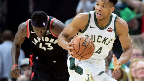 <p>               Toronto Raptors forward Pascal Siakam (43) tries to chase down Milwaukee Bucks forward Giannis Antetokounmpo (34) during the first half in Game 1 of the NBA basketball playoffs Eastern Conference final in Milwaukee on Wednesday, May 15, 2019. (Frank Gunn/The Canadian Press via AP)             </p>