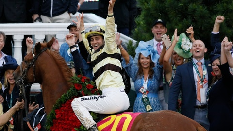 <p>               Flavien Prat celebrates after riding Country House to victory during the 145th running of the Kentucky Derby horse race at Churchill Downs Saturday, May 4, 2019, in Louisville, Ky. (AP Photo/John Minchillo)             </p>